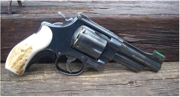 revolver on wooden steps
