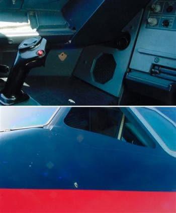 Bullet hole through cockpit.