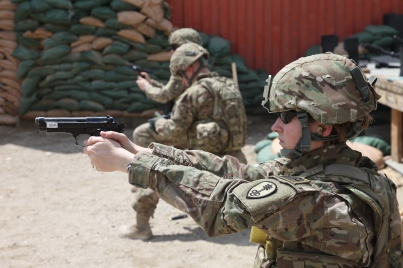 soldiers shooting Berettas in Afghanistan