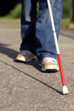bottom half of blind person with a cane