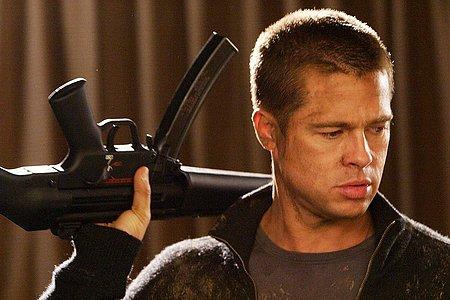 Brad Pitt with a gun in a movie