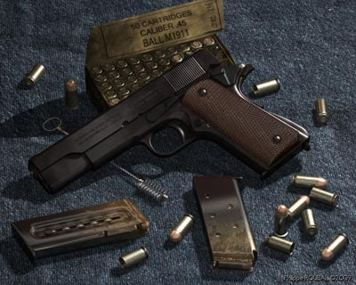 colt 1911 with bullets beside it