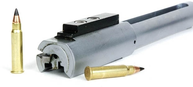 rifle part next to bullets