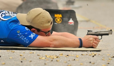 FN teammember shooting the new FNS-9 Competition pistol in the prone position