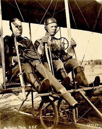 Capt. Charles Chandler with prototype Lewis Gun and Lt. Roy Carrington Kirtland in a Wright Model B Flyer after the first successful firing of a machine-gun from an aeroplane in June 1912. (Photo Courtesy of Wikipedia)