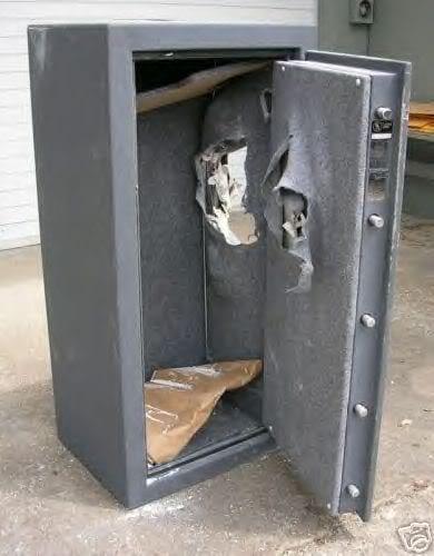 A hammered open safe