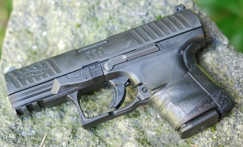 A Custom PPQ Compact sitting on a rock