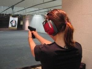 Girl shooting at the range.