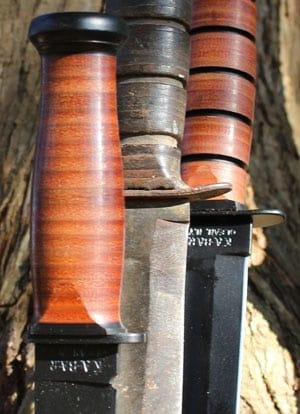 leather handles on three ka bars