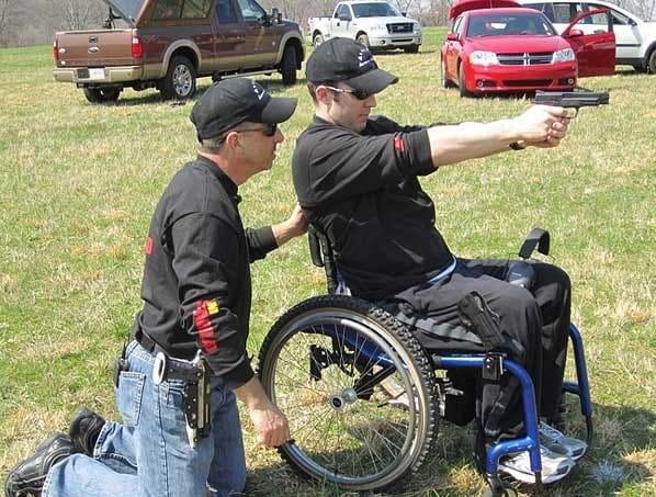 Smith & Wesson teammember Trevor Baucom shooting a pistol.