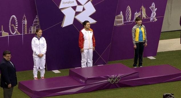 Silver medalist Celine Goberville of France, gold medalist Wenjun Guo, and bronze medalist Olena Kostevych of Ukraine.