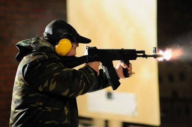 Man test-firing an AK-12