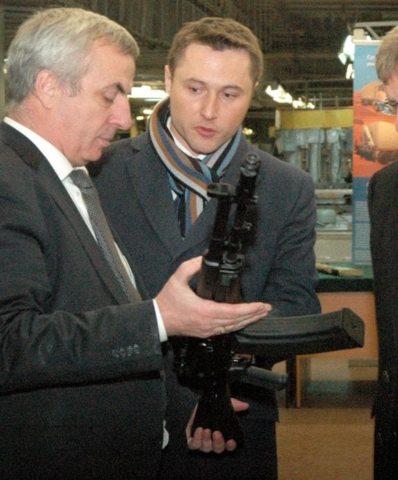 men examining russian ak rifles