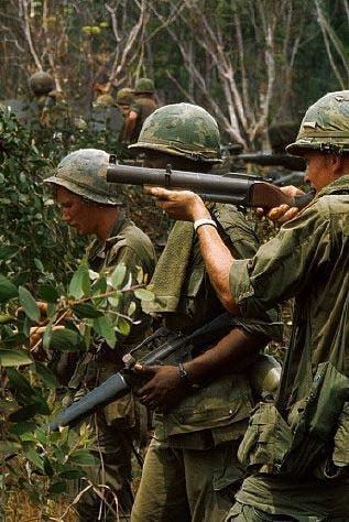american soldiers in vietnam war with grenade launchers