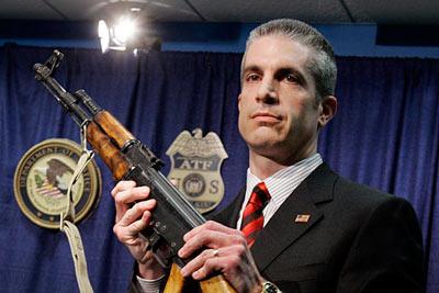 atf agent holding a gun