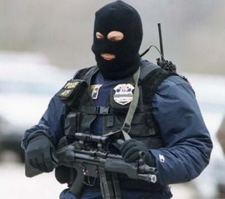 swat team member with face covered by ski mask