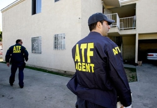 2 atf agents outside apartment building