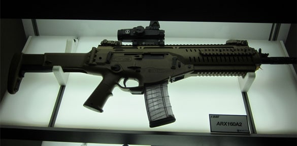 The Beretta ARX-160 rifle sitting on an illuminated platform.