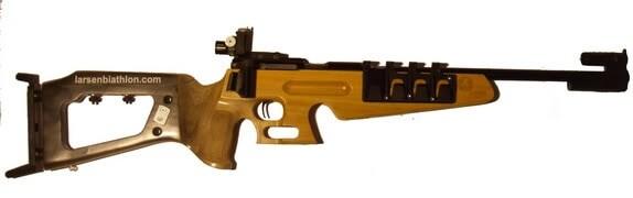 light colored wood biathlon rifle