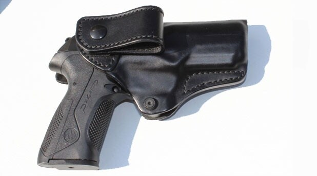 Beretta PX4 in a leather holster