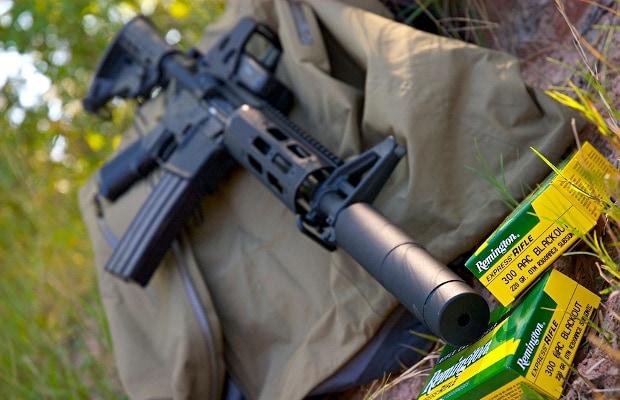 bushmaster rifle outdoors sitting on gear