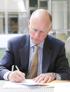 jerry brown signing a bill into law