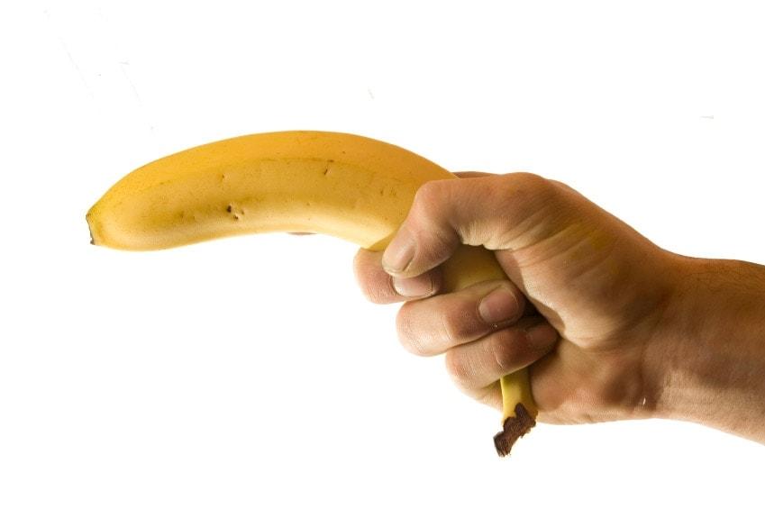 stock photo of banana being held like a gun