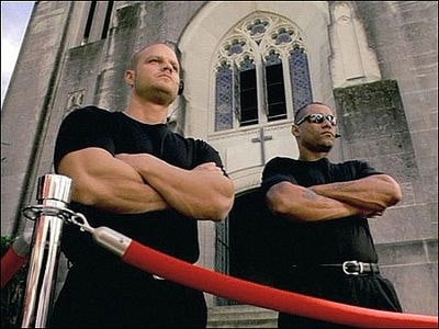 2 security men outside of church