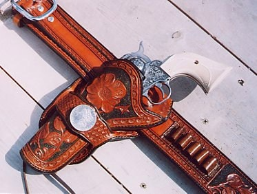 old school handgun in leather holster