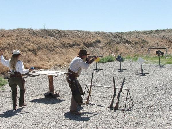 cowboys shooting outside at the range