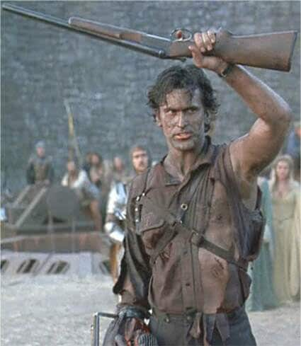 bruce campbell holding a shotgun in army of the dead