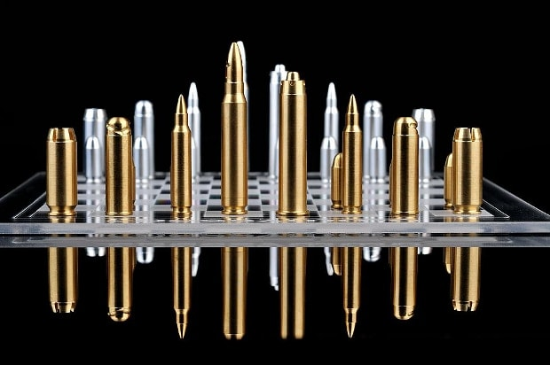 bullet chess pieces on glass board