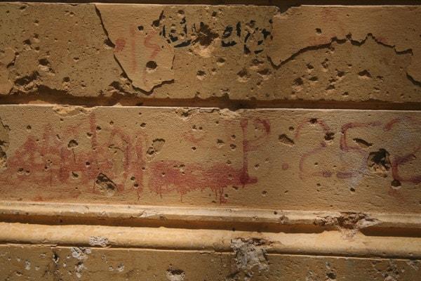 bullet holes on brick