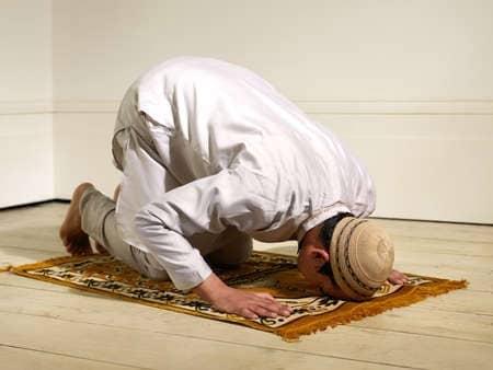 muslim man praying on carpet