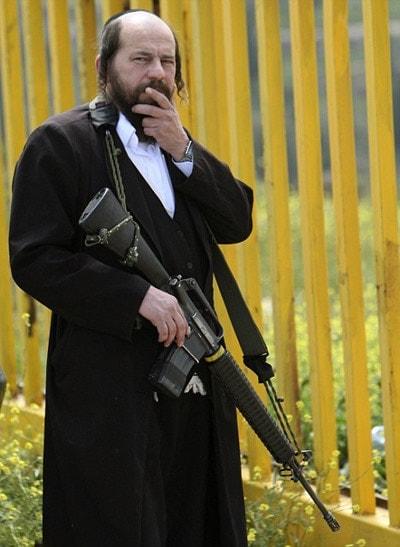 rabbi holding high powered rifle