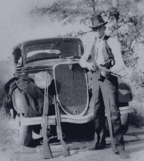 Clyde Barrow with BAR and sawed off shotgun.