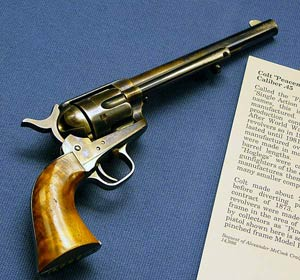 colt peacemaker on blue cloth