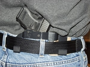 handgun in holster concealed carry jeans