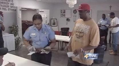 officer inspecting firearm