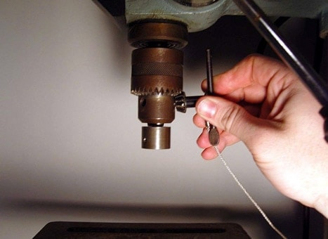 Attaching a roll crimping tool to a drill press is as easy as swapping drill bits. (Photo: Jason Wimbiscus)