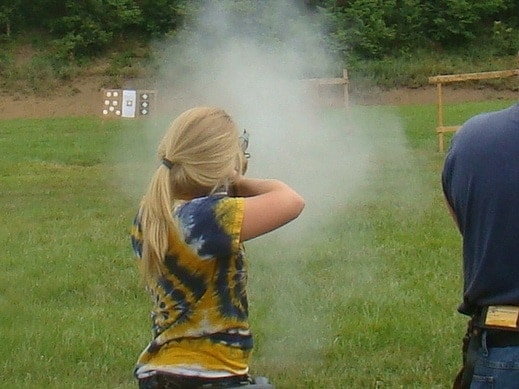 Daughter Shooting a Rifle at the range outdoors