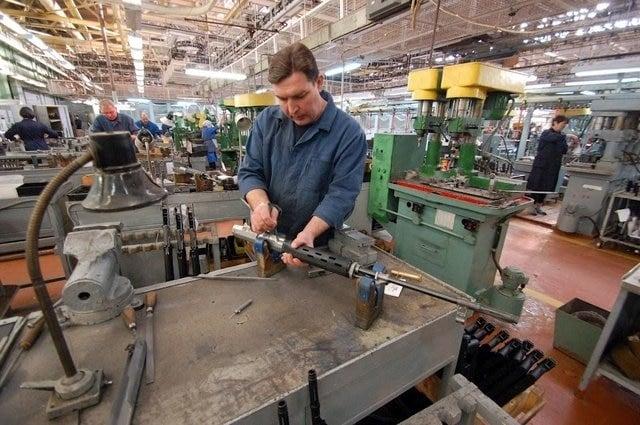 Man assembling Dragunov SVD