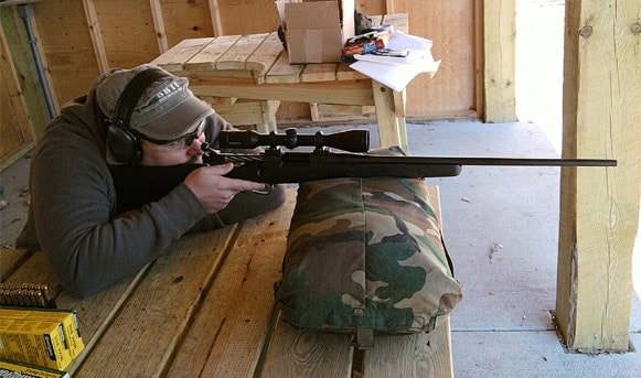 Ballistics By The Inch teammember shooting the Ed Brown Damara rifle at the bench.