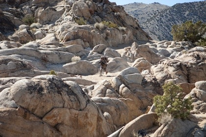 distant shot of marine on rocky mountainside