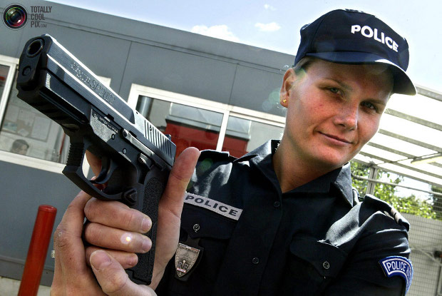 female french police officer with a sig sauer SP2022