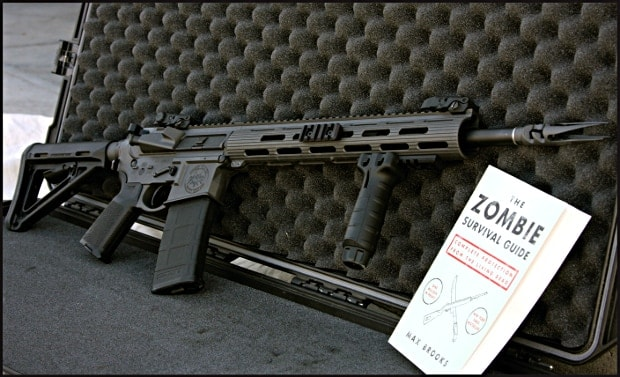 sts limited zombie gun with book against case