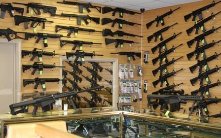 rifles on the shelf of a gun store