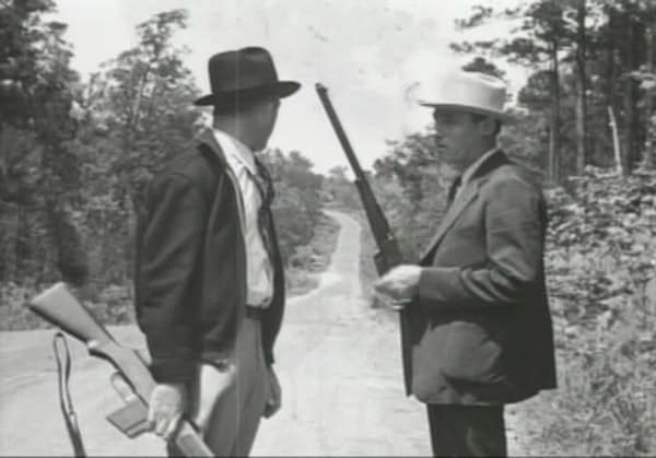 frank hamer and associate with rifles in hand