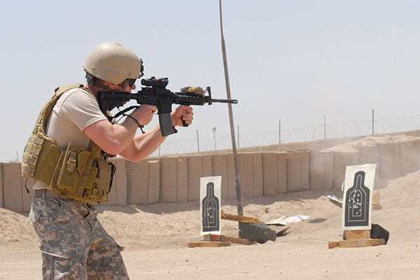 A Green Beret fires a M4A1 carbine at a range in Iraq.