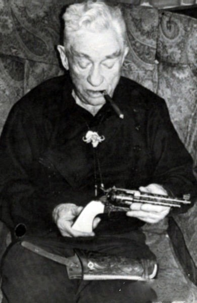 elmer keith smoking cigar with gun in hand